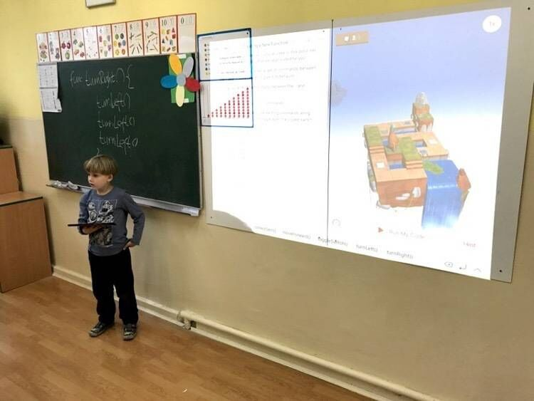 My son explains simple programming concepts to his classmates